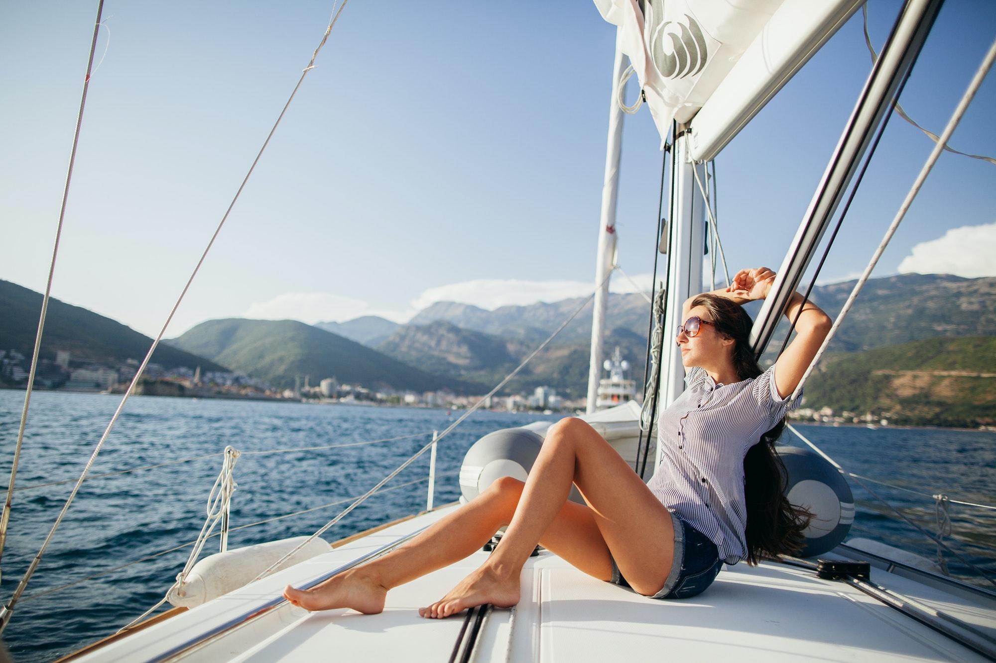 sexy girl in swimwear on yacht in tropics